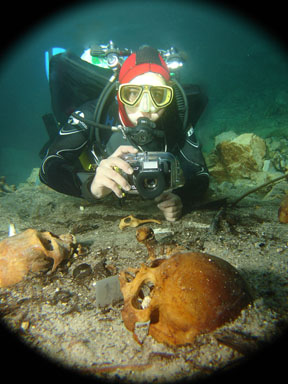 Documenting a skull in an ossuary centote in Yucatan. Photo courtesy Arturo Gonzales Gonzales